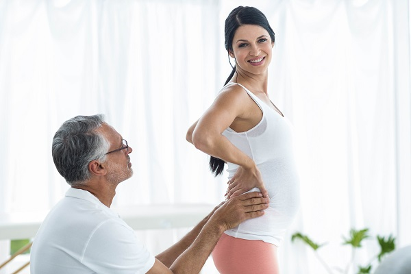 physiotherapy to pregnant woman on exercise ball